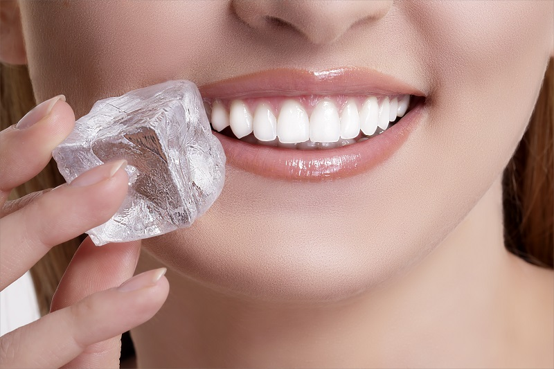 Porcelain veneers patient biting ice
