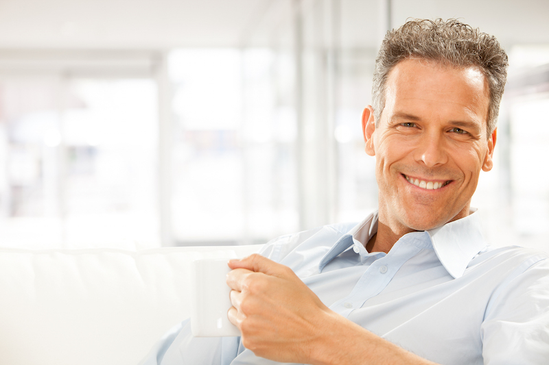Middle aged man relaxing after dental implant recovery | Las Vegas Cosmetic Dentist Dr. Jorge Paez
