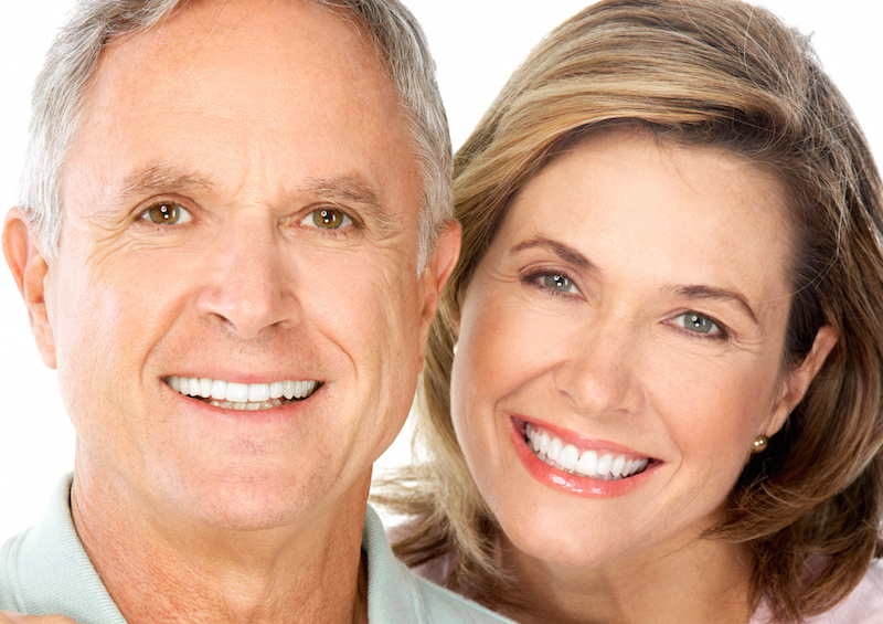Smiling older couple with nice teeth and strong jaws due to permanent dentures